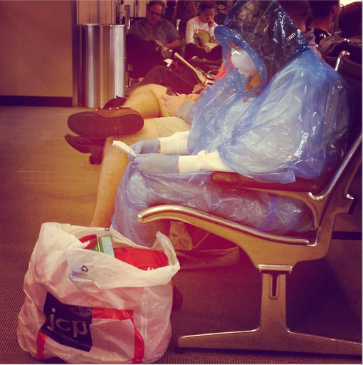 RT Lady just chilling at Dulles in her homemade Hazmat suit  - embedded image