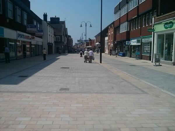 Bromsgrove high street looks good now. But how long before a utility digs it up or the council patch it with tarmac?  - embedded image