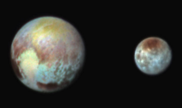 RT RELEASED: Enhanced color image shows #Pluto's compositional diversity during #PlutoFlyby. http://t.co/8468Jp50Tm  - embedded image