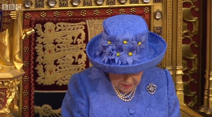 RT Not to be facetious but the Queen's hat looks like the European Union flag  - embedded image 1
