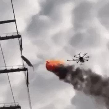 RT Drone with a flamethrower for removing litter from power lines.  - embedded image